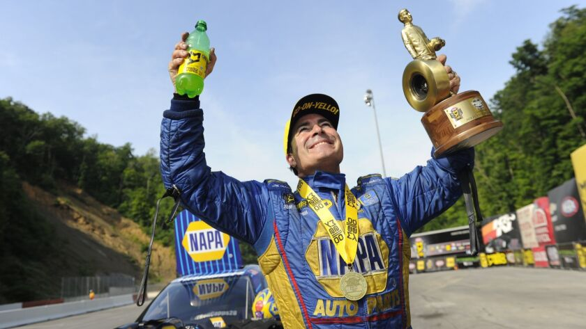 In this photo provided by the NHRA, Ron Capps celebrates after securing his first victory of the sea
