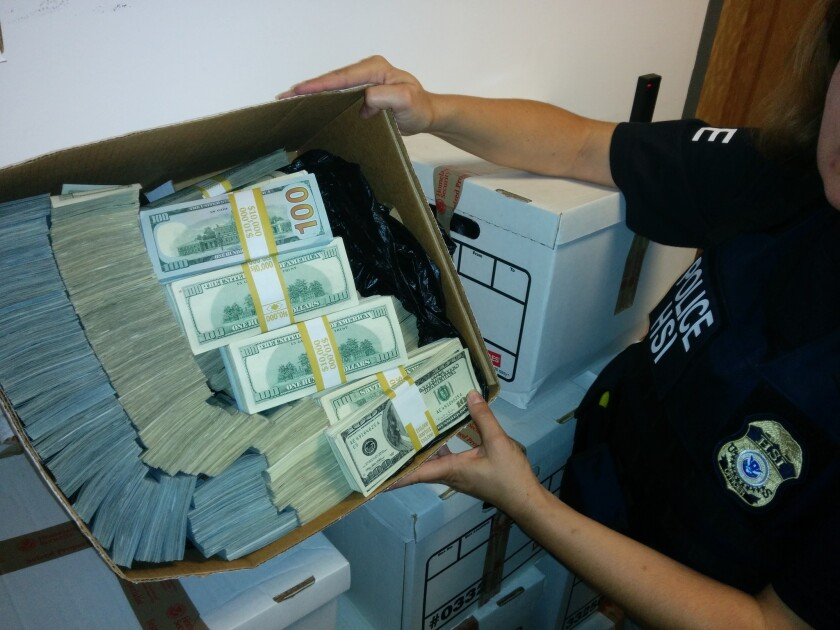 Cash seized during a police raid in downtown Los Angeles in 2014