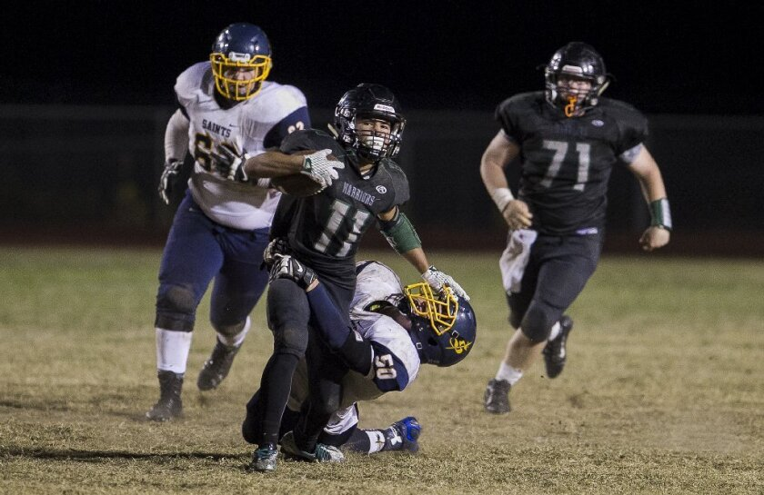 Jordan Leonard (11) had a big year for Brethren Christian, as he led the county in rushing yards (2,637) and scoring (240 points).