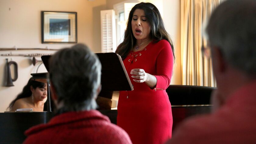 Soprano Priti Gandhi, seen here performing at the home of Marty and Sherry Bloom in La Jolla, said house concerts invigorate her passion for performing.