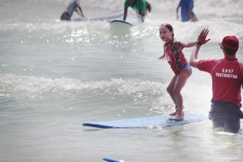 A young surfers show her skills Monday at La Jolla Shores. Phil Dailey photo