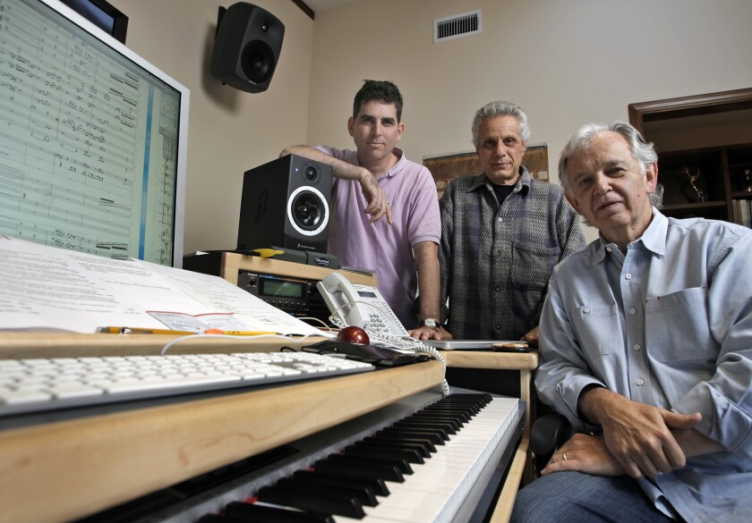 Bruce Broughton, right, James DiPasquale, center, and Alan Elliott take a break in Broughton's home studio. Broughton was stripped of an Oscar nomination earlier this year.