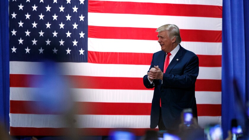 Donald Trump arrives at a town hall Wednesday in Daytona Beach, Fla.