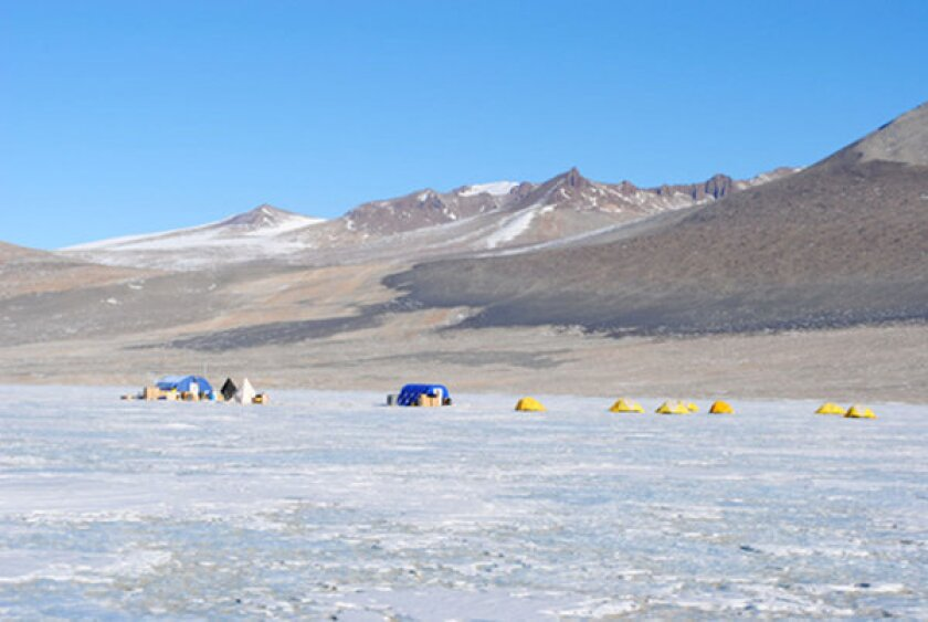 Lake Vida, an Antarctic lake sealed under 50 feet of ice, is nonetheless teeming with bacteria, according to a new study. Above, the researchers' field camp at Lake Vida during the study.