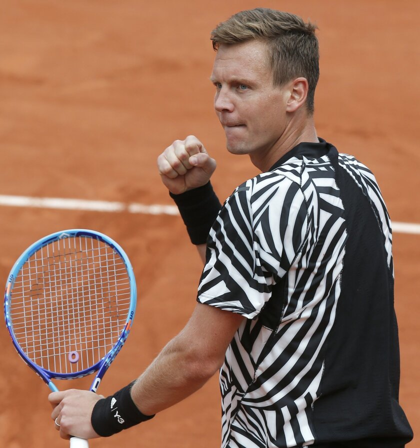 Tomas Berdych of the Czech Republic celebrates winning his second round match of the French Open tennis tournament against Tunisia's Malek Jaziri at the Roland Garros stadium in Paris, France, Thursday, May 26, 2016. (AP Photo/Michel Euler)