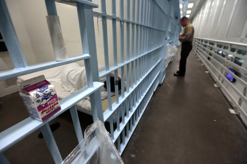 An L.A. County sheriff's deputy checks on an inmate at Men's Central Jail.