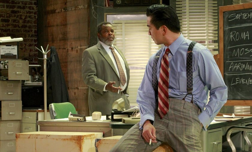"Anthony Thomas (left) and Johnny Wu rehearse a scene from the La Jolla Playhouse production of ""Glengarry Glen Ross."""
