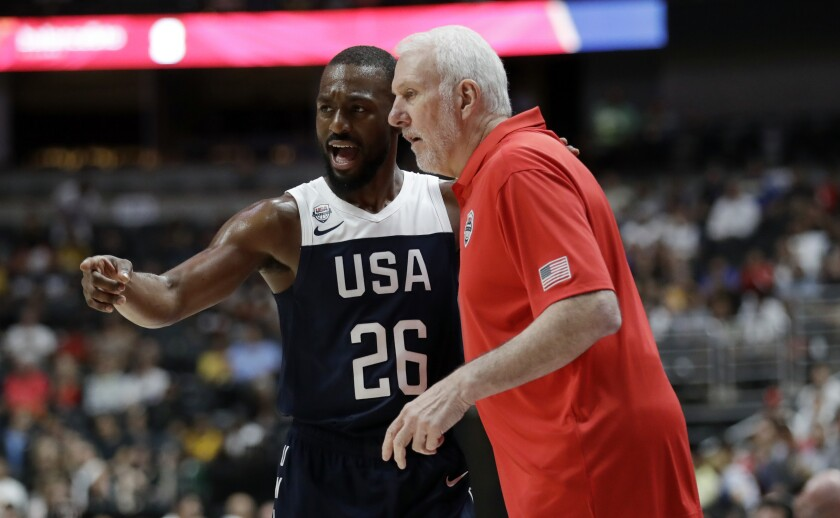 Team USA coach Gregg Popovich talks to guard Kemba Walker during an exhibition game against Spain on Aug. 16, 2019, in Anaheim.