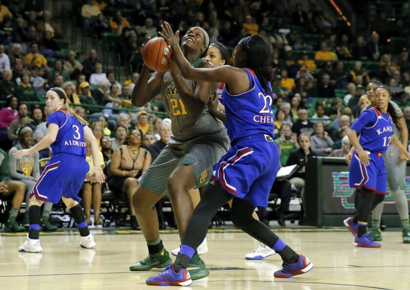 Baylor center Kalani Brown (21) goes up for a shot against Kansas' Chayla Cheadle (22) in the second half of an NCAA college basketball game, Saturday, Feb. 6, 2016, in Waco, Texas. Brown lead all scoring with 18 points in the 81-49 Baylor win. (AP Photo/Tony Gutierrez)