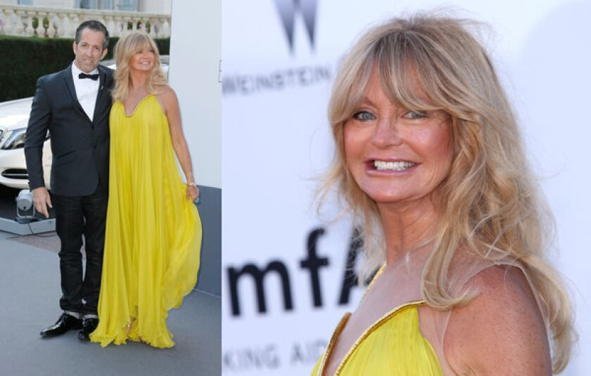 Actress Goldie Hawn, 67, with designer Kenneth Cole at the amfAR gala in Cannes.