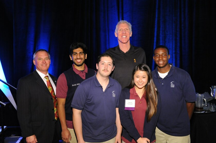 Bill Walton with a teacher and students from Preuss School at UCSD who are part of CONNECT's Entrepreneurs for Young Innovators program.