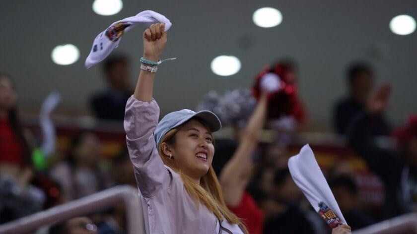 A fan waves a towel during an NHL preseason game Saturday in Beijing.