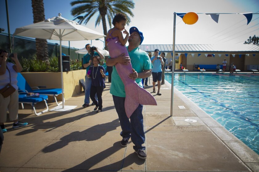 San Diego, Ca, USA, Sunday, November 03, 2013._ 5-yr-old Kaia Foster of Rancho Penasquitos has kidney cancer and the Make-a-Wish Foundation has granted her wish to become a mermaid.  Her father, Josh Foster carries her to the pool where she will swim with the mermaids and play games.  PHOTO BY CRIS