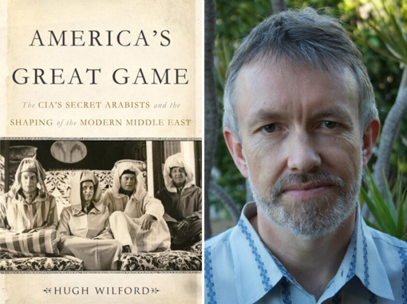 """Author Hugh Wilford and the cover of his book, """"America's Great Game."""""""