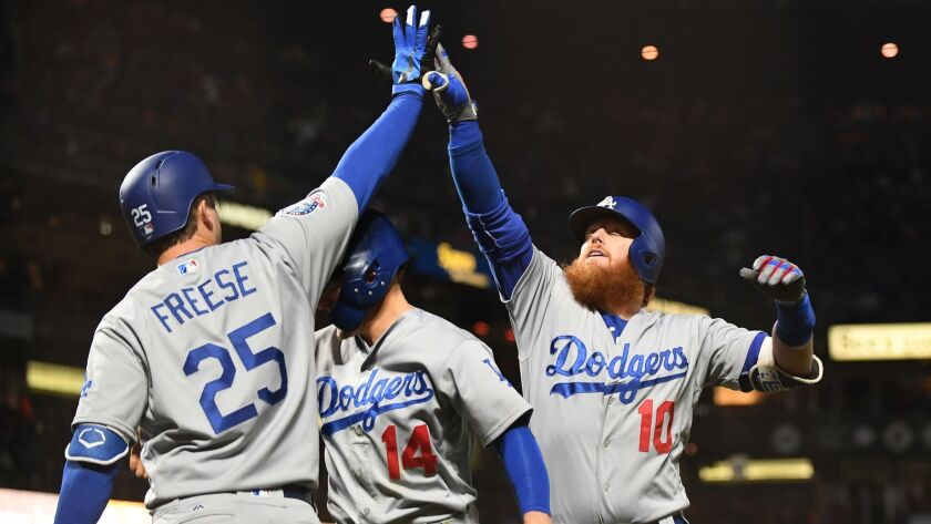 SAN FRANCISCO, SEPTEMBER 28, 2018-Dodgers Justin Turner, right, celebrates his two-run home run with