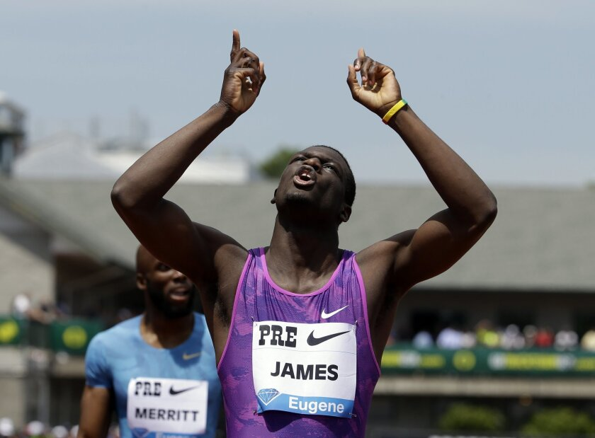 Kirani James, from Grenada, celebrates after winning the 400-meter race during the Prefontaine Classic track and field meet in Eugene, Ore., Saturday, May 30, 2015. (AP Photo/Don Ryan)