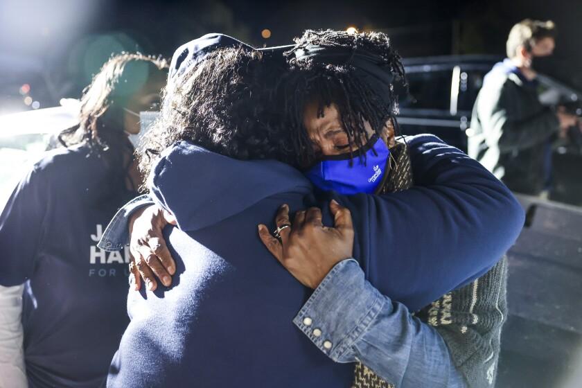 Democratic U.S. Senate candidate Jaime Harrison's mother, Patricia Stewart, hugs her sister.