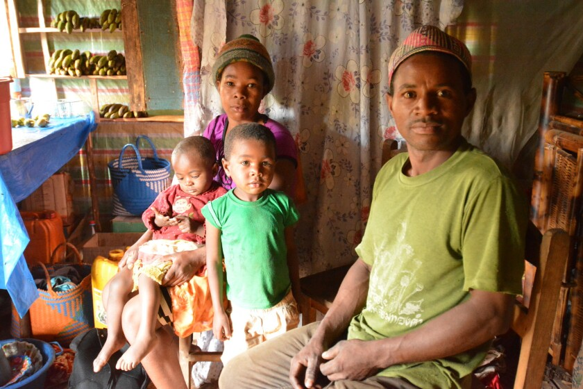 Filgence Rakotoarimanana, his wife, Soahamarina, and two of their six children. The impoverished far