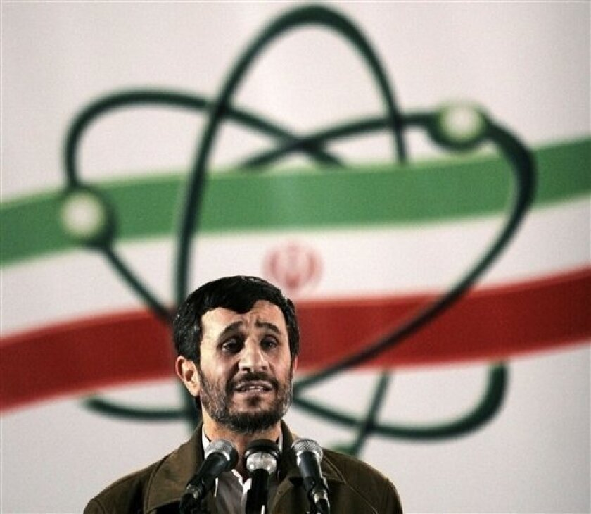In this April, 9, 2007 file photo, Iranian President Mahmoud Ahmadinejad, speaks at a ceremony in Iran's nuclear enrichment facility in Natanz, 300 Kilometers (186 miles) south of capital Tehran, Iran.
