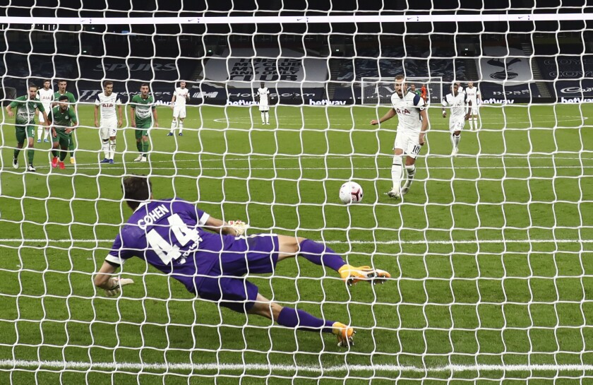 Tottenham's Harry Kane shoots to score a penalty kick during a Europa League soccer match between Tottenham Hotspur and Maccabi Haifa in London, Thursday, Oct. 1, 2020. (Clive Rose/Pool via AP)