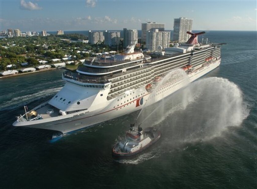 """FILE - The Carnival Legend, a 2,100-passenger, 960-foot-long cruise ship arrives at Port Everglades in Fort Lauderdale, Fla., in this Nov. 8, 2002 file photo. Carnival Cruise Lines says another of its ships has experienced problems and is heading back to the Port of Tampa. Late Thursday, March 14, 2013 the company said """"a technical issue"""" affecting the sailing speed of the Legend forced the cancellation of a stop at Grand Cayman Islands. The Carnival Dream experienced problems with an on-board g"""