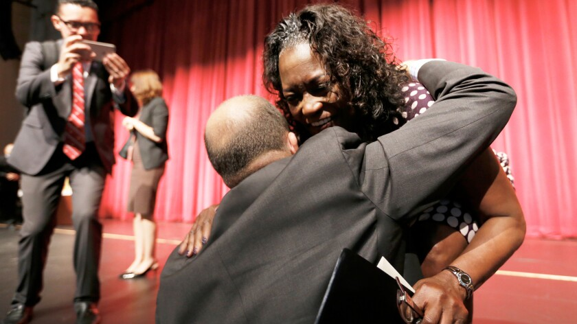 Supt. Michelle King and school board President Steve Zimmer hug after her state of the district address at Garfield High School in which she praised the class of 2016 s record graduation success.