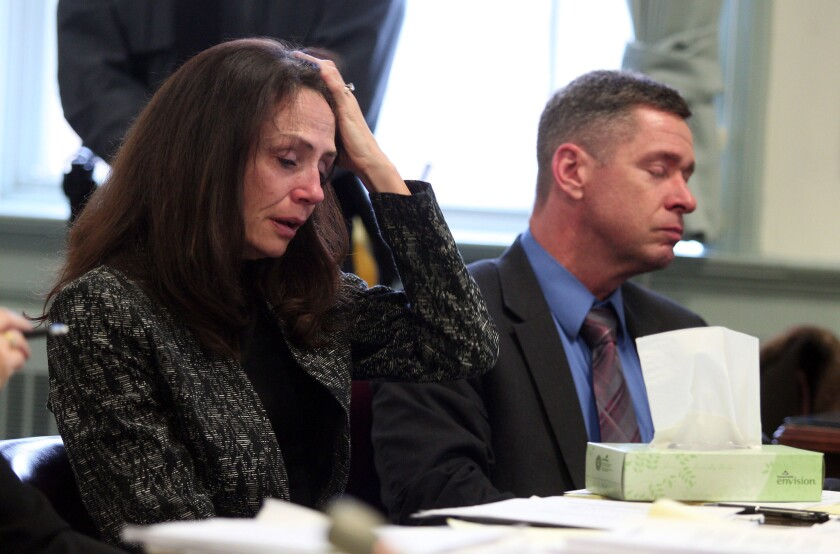 Elizabeth and Sean Canning listen to testimony in Morris County Superior Court in Morristown, N.J., on Tuesday. Their daughter Rachel, 18, is suing them for financial support after she claims they threw her out of the house.