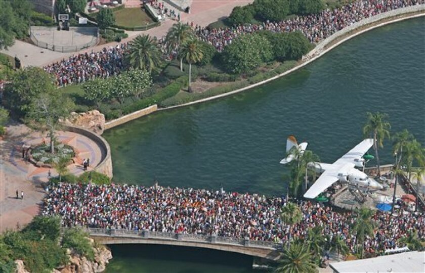 Thousands of people line up Friday, June 18, 2010 for the grand opening of the Wizarding World of Harry Potter at Universal's Islands of Adventure in Orlando, Fla. (AP Photo/ Orlando Sentinel, Red Huber)