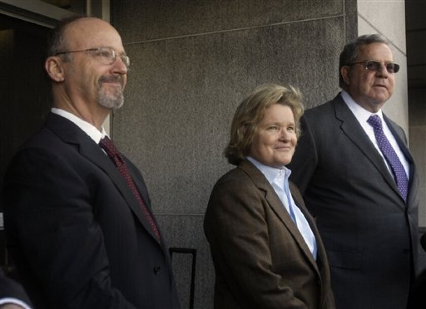 Ted Cassman, Cris Arguedas, and Allen Ruby, from left, attorneys for Barry Bonds, talk to reporters outside the federal courthouse after the first day of Bonds' perjury trial in San Francisco, Monday, March 21, 2011. (AP Photo/Jeff Chiu)