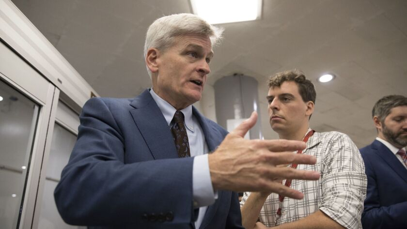 Sen. Bill Cassidy, R-La., tries to explain his Obamacare repeal bill on Wednesday. A revised version would be even worse for people with pre-existing conditions than Cassidy's original.