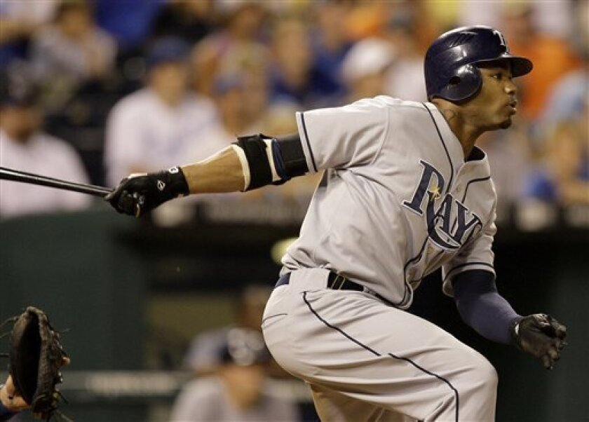 Tampa Bay Rays' Carl Crawford watches his two-run triple during the eighth inning of a baseball game against the Kansas City Royals on Saturday, July 26, 2008, in Kansas City, Mo. (AP Photo/Charlie Riedel)