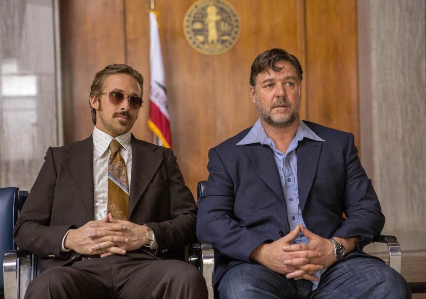 An undated handout film still provided by the Cannes Film Festival organisation on 14 May 2016 shows New Zealand actor Russel Crowe (R) and US actor Ryan Gosling in a scene of 'The Nice Guys'. The movie by US director Shane Black is presented out of competition at the 69th annual Cannes Film Festiv