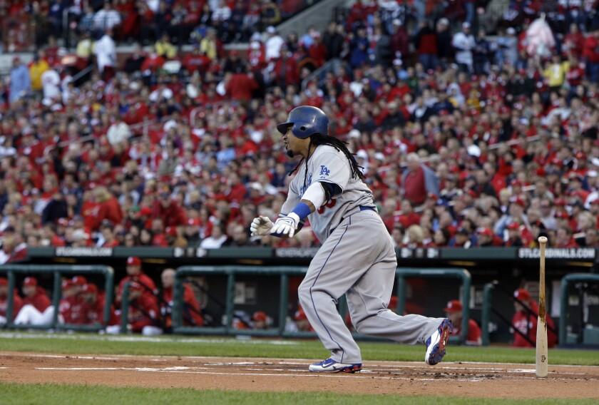Dodgers left fielder Manny Ramirez runs after