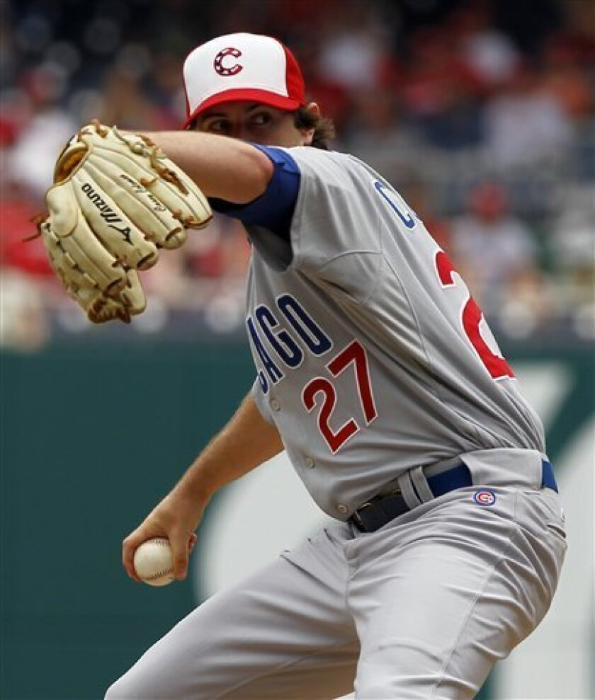 Chicago Cubs pitcher Casey Coleman winds up during the first inning of a baseball game with the Washington Nationals at Nationals Park on Monday, July 4, 2011 in Washington.(AP Photo/Alex Brandon)