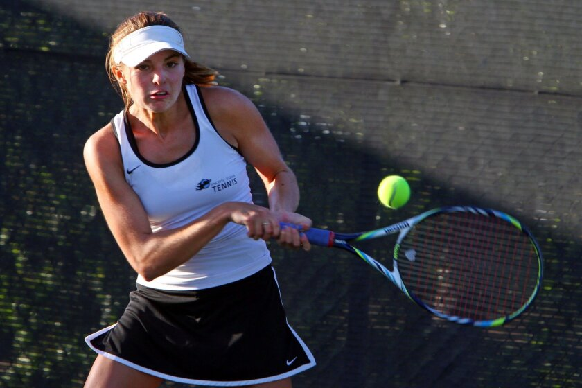 Pacific Ridge junior Julia Gonda returns a shot while winning two of three singles sets for the Firebirds.