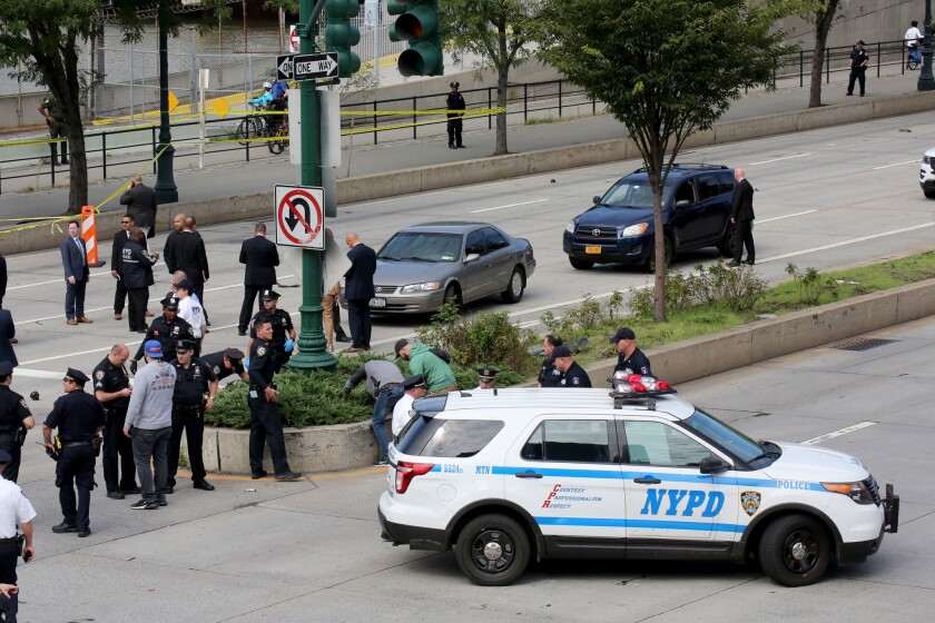 NYPD ESU Officers, Detectives and DEA Agents search for evidence at W. 46 St. and 12th Ave. after shots were fired when DEA Agents tried to apprehend a suspect they have been following.