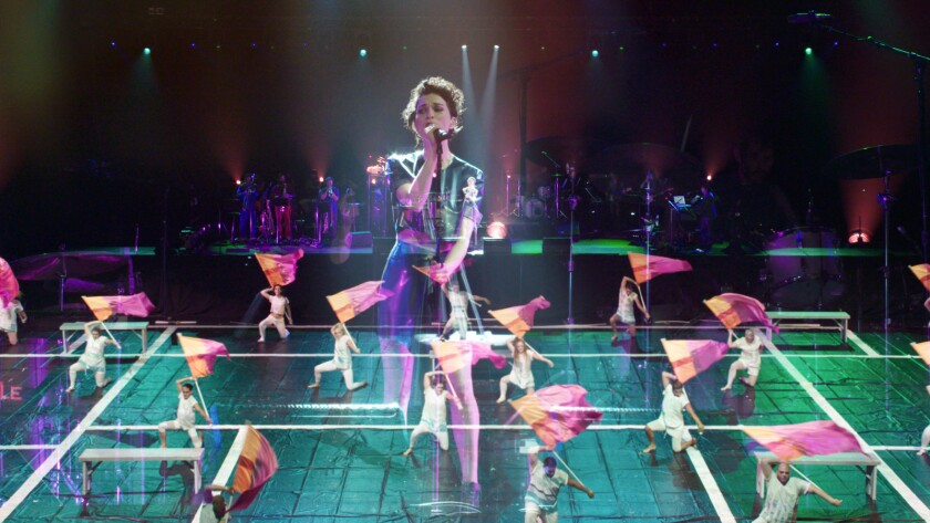 """Singer St. Vincent with color guard team Field of View from West Chester, Penn., in the documentary """"Contemporary Color."""""""