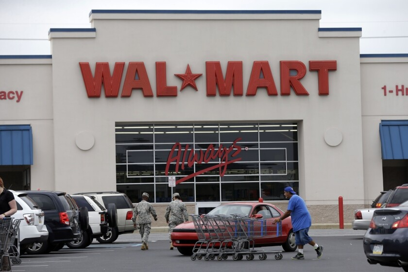The D.C. Council has passed a bill requiring non-unionized, big-box retailers like Wal-Mart to pay workers $12.50 an hour, more than 50% higher than other companies. Now the nation's largest retailer is threatening to abandon three and possibly all six of its D.C. projects. Above, a Wal-Mart store in Bristol, Pa.