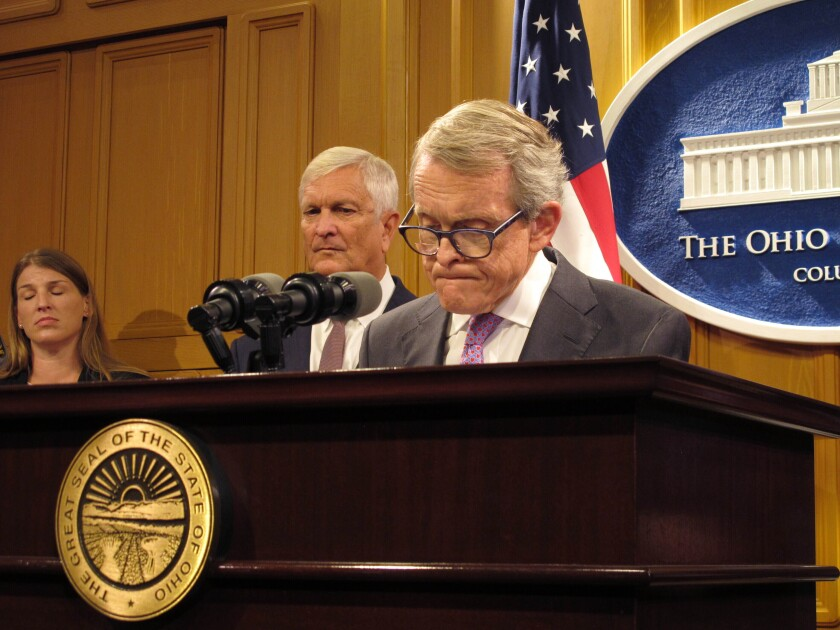 Ohio Gov. Mike DeWine, right, and state Public Safety Director Tom Stickrath speak at a news conference Aug. 30 in Columbus.