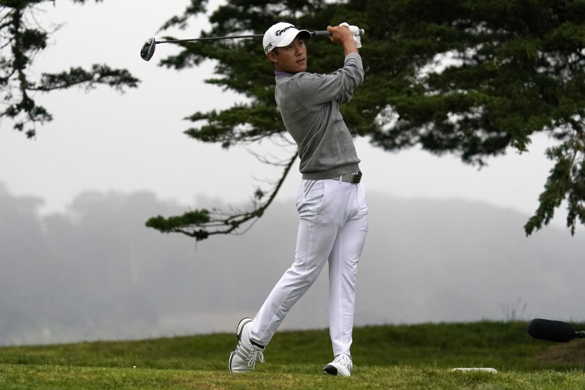 Collin Morikawa watches his tee shot on the 16th hole during the final round of the PGA Championship golf tournament at TPC Harding Park Sunday, Aug. 9, 2020, in San Francisco. (AP Photo/Jeff Chiu)