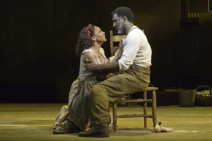 "Audra McDonald and Norm Lewis in a scene from ""The Gershwins' Porgy and Bess"" at New York's Richard Rodgers Theatre."