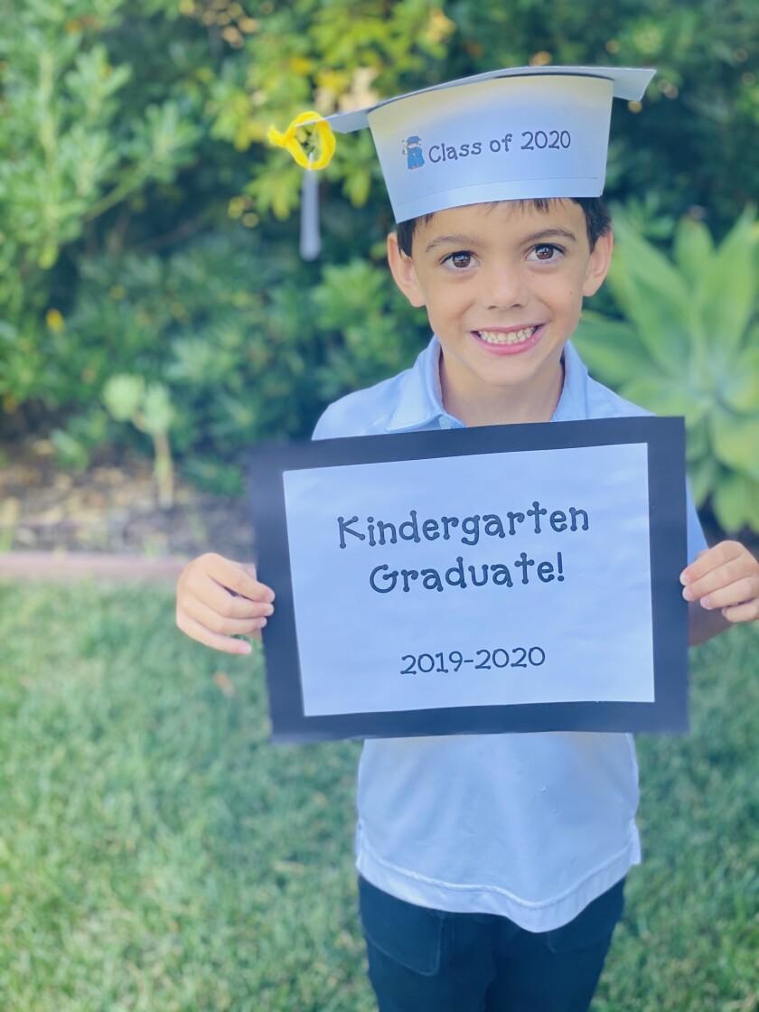 R. Roger Rowe kindergarten graduate Ivan Salmen.