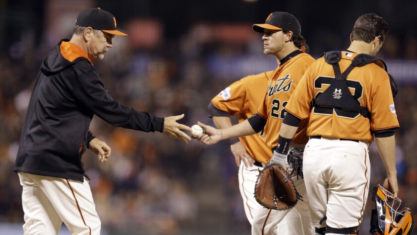 San Francisco Giants Manager Bruce Bochy, left, removes starting pitcher Jake Peavy from the game during a 9-0 loss to the Arizona Diamondbacks on Friday.