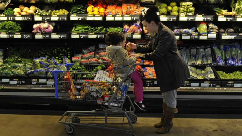 A Rhode Island woman uses food stamps to stock up for her family.