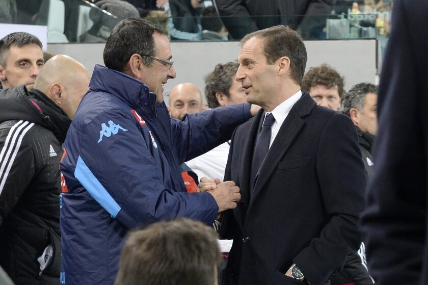 Napoli coach Maurizio Sarri, left, and Juventus coach Massimiliano Allegri, right, greet before the start of a Serie A soccer match between Juventus and Napoli at the Juventus stadium, in Turin, Italy, Saturday, Feb. 13, 2016. (AP Photo/Massimo Pinca)