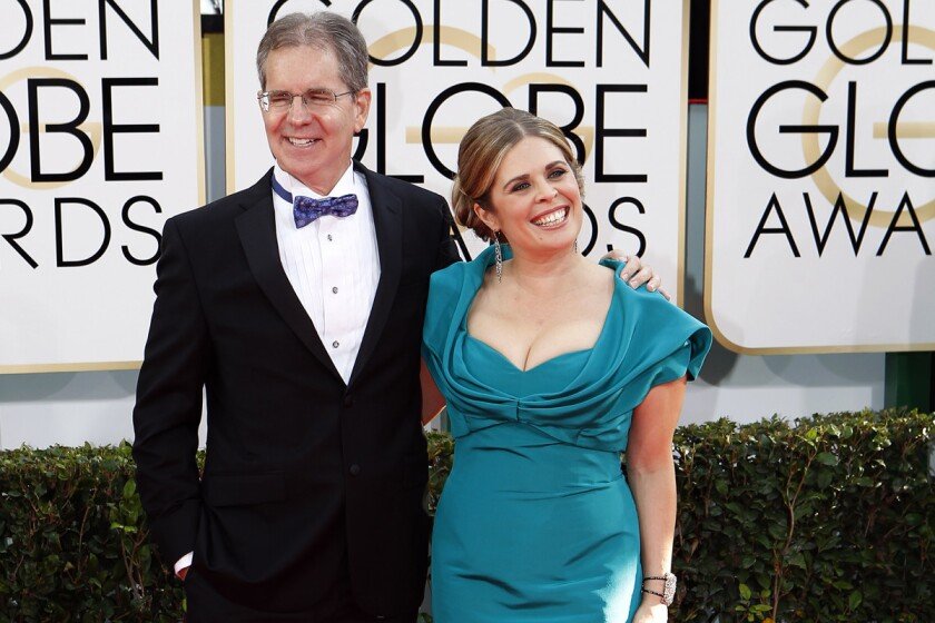 """Chris Buck and Jennifer Lee, winners of best animated feature Film for """"Frozen,"""" at the Golden Globe Awards show on Jan. 12, 2014, in Beverly Hills."""