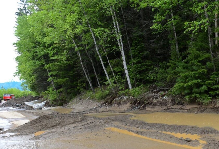 Traffic on the popular Going-to-the-Sun Road near Apgar Campground in Glacier National Park, Mont., is diverted because of a mudslide to one lane Wednesday, May 25, 2016. Park officials say beavers are to blame for the third straight day the road has been closed due to a mudslide, dragging trees an
