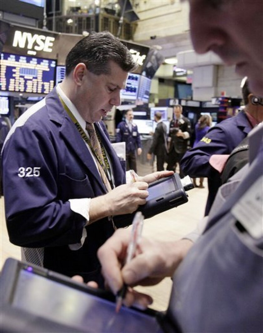 In this Feb. 28, 2012 photo, traders work on the floor of the New York Stock Exchange. Now that the Dow Jones industrial average has closed above 13,000, an all-time high is in sight — just 1,160 points away. But the coast is not quite clear for the markets or the economy.(AP Photo/Richard Drew)