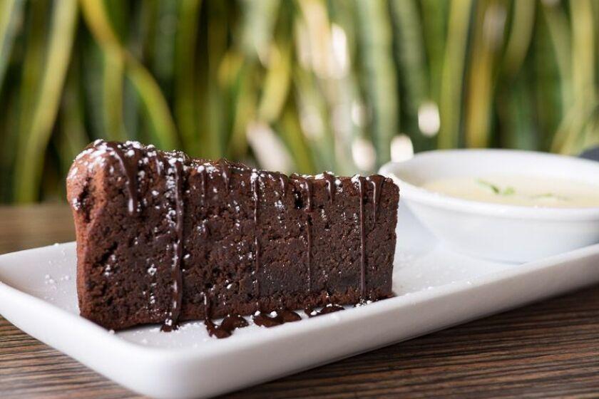 Torta Caprese, flourless chocolate cake with whipped cream.