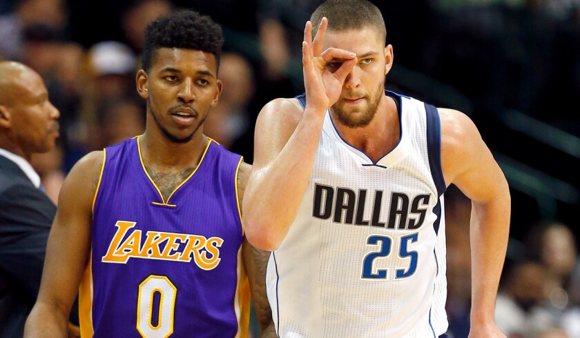 Mavericks forward Chandler Parsons celebrates after scoring against Nick Young (0) and the Lakers in the second half.